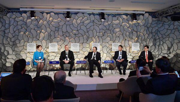 Ильхам Алиев в Давосе принял участие в сессии Развитие инициативы Один пояс, один путь: взгляд Китая на триллион долларов - Sputnik Азербайджан