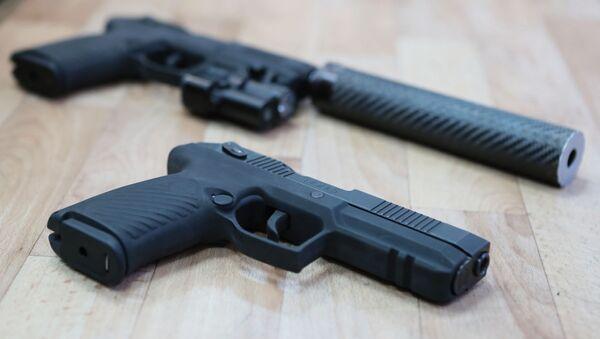 Самозарядный пистолет Удав, разработанный в Центральном научно-исследовательском институте точного машиностроения (ЦНИИточмаш) корпорации Ростех - Sputnik Азербайджан