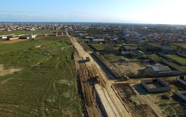 Строительство новой автомобильной дороги в Сураханском районе - Sputnik Азербайджан