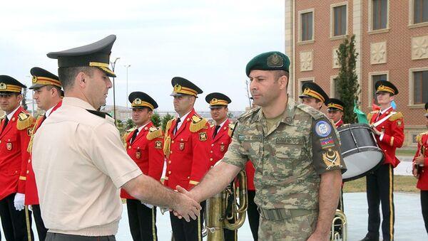 Группа азербайджанских миротворцев вернулась из Афганистана - Sputnik Азербайджан