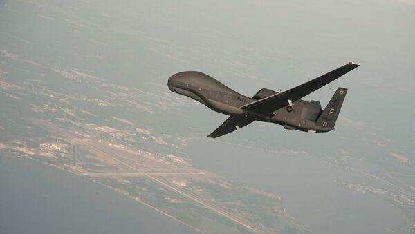 Американский стратегический разведывательный БПЛА RQ-4 Global Hawk, архивное фото - Sputnik Azərbaycan