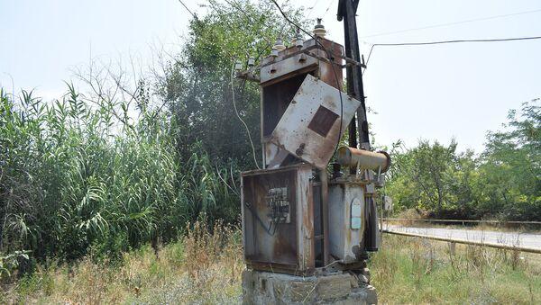Bərdə rayonu Qaradəmirçi kəndində qəzalı vəziyyətdə olan elektrik transformatoru - Sputnik Азербайджан