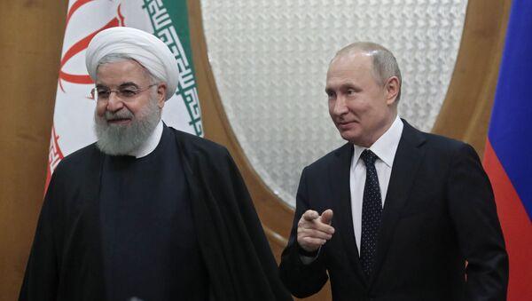 Rusiya prezidenti Vladimir Putin və İran prezidenti Həsən Ruhani, arxiv şəkli - Sputnik Azərbaycan