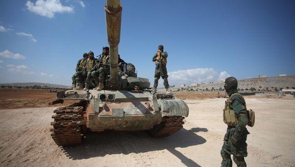 Террористы группировки «Джейш аль-Изза» действующей в северной провинции Хама и некоторых частях Идлиба, фото из архива - Sputnik Азербайджан