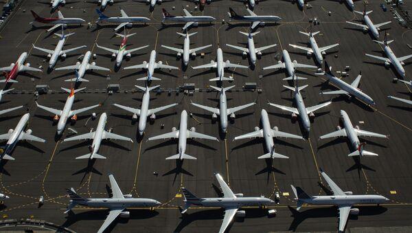 Самолеты Boeing 737 MAX видны припаркованными возле Boeing Field - Sputnik Азербайджан