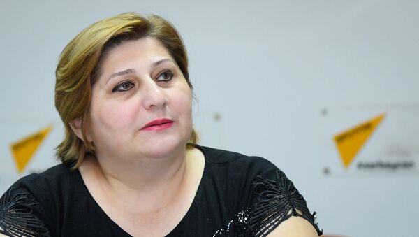 Председатель общественного объединения Во имя женского лидерства Улькер Абдуллаева - Sputnik Azərbaycan