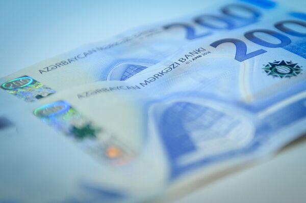 27 лет единственной денежной единицей, имеющей хождение в Азербайджане, является азербайджанский манат.  - Sputnik Азербайджан