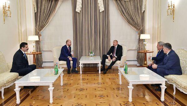 Президент Азербайджана Ильхам Алиев в четверг принял делегацию во главе с председателем Всемирной конфедерации этноспорта Билалом Эрдоганом - Sputnik Азербайджан