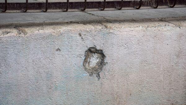 Последствия обстрела, фото из архива - Sputnik Азербайджан