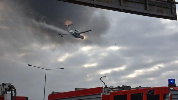 Тушение пожара в ТЦ EuroHome - Sputnik Азербайджан