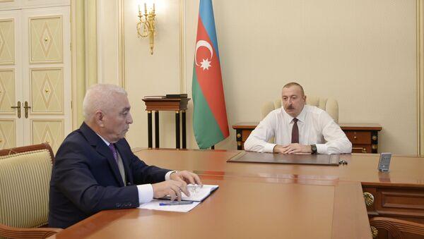 """Prezident İlham Əliyev """"Azərenerji"""" Açıq Səhmdar Cəmiyyətinin (ASC) prezidenti Baba Rzayevi qəbul edib. - Sputnik Азербайджан"""