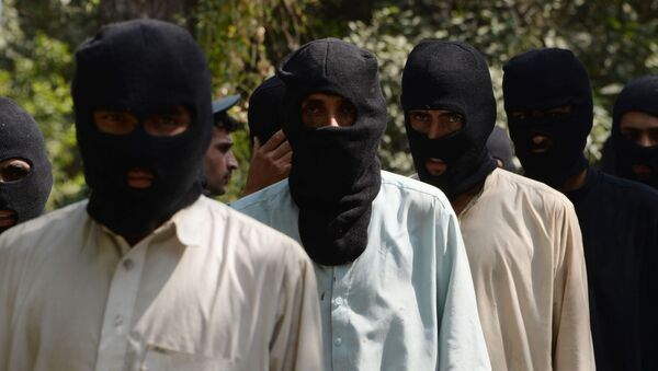 Боевики ИГ (запрещена в России) и движения Талибан в полицейском отделении в Афганистане. Архивное фото  - Sputnik Азербайджан