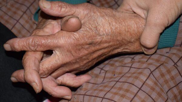 Пожилая женщина, фото из архива - Sputnik Азербайджан