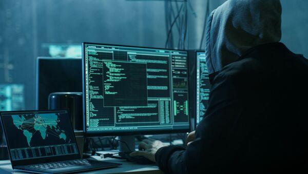 Хакер во время работы  - Sputnik Azərbaycan