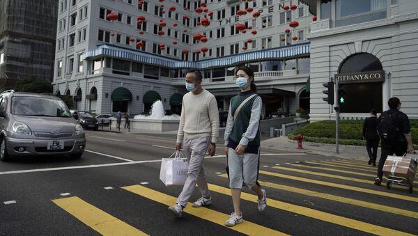 Туристы в медицинских масках в Гонконге, фото из архива - Sputnik Азербайджан