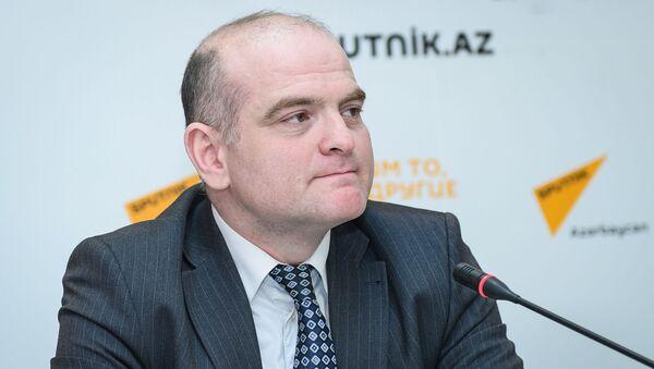 Заместитель директора Русской школы экономики UNEC Эльшад Мамедов - Sputnik Азербайджан