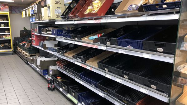 A view of empty shelves at a supermarket as people began stockpiling food just hours after the Danish government introduced measures to contain the spread of the coronavirus in Copenhagen - Sputnik Azərbaycan
