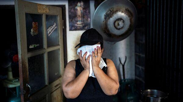 Женщина на кухне. фото из архива - Sputnik Азербайджан