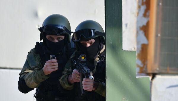 Показательные выступления сотрудников спецподразделения ОМОН, фото из архива - Sputnik Azərbaycan