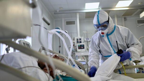 Пациент с COVİD-19, фото из архива - Sputnik Азербайджан