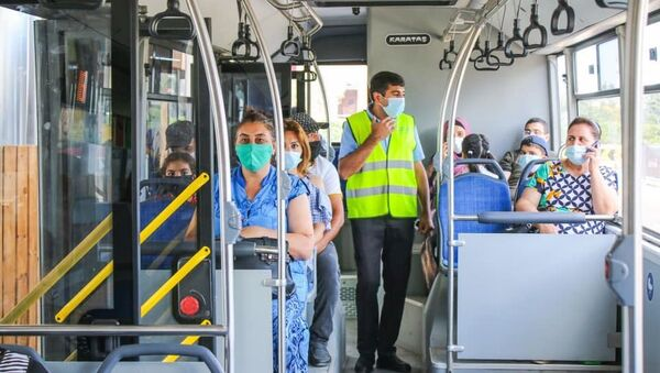 Контролер в автобусе, фото из архива - Sputnik Азербайджан